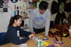 Duke students decorate auction paddles on February 5th to be used for the March 5th Grand Finale auction.